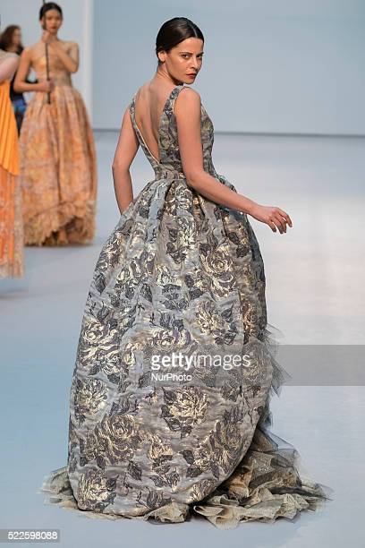 A model walks the catwalk during the De la Cierva y Nicolas during Bridal Spring/Summer 2017 Presentation at the Cibeles Palace on 20 April 2016 in...