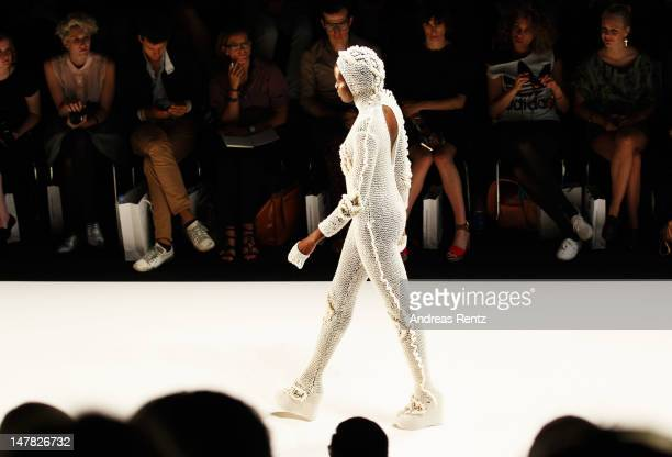 A model walks the catwalk during the Designer For Tomorrow show at the MercedesBenz Fashion Week Spring/Summer 2013 on July 4 2012 in Berlin Germany