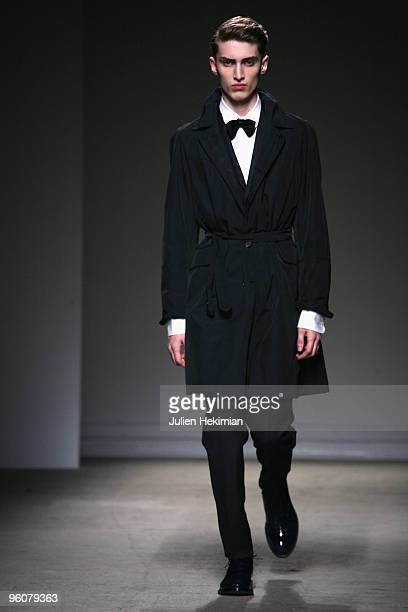 Model walks the catwalk during the Dunhill fashion show during Paris Menswear Fashion Week Autumn/Winter 2010 at Palais De Tokyo on January 23 2010...