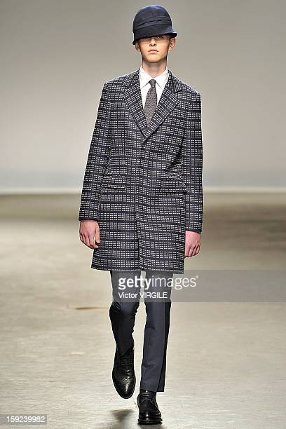 A model walks the catwalk during the E Tautz Ready to wear Fall/Winter 20132014 show at the London Collections MEN AW13 at The Old Sorting Office on...