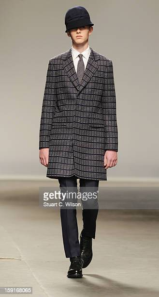 A model walks the catwalk during the ETautz show at the London Collections MEN AW13 at The Old Sorting Office on January 9 2013 in London England