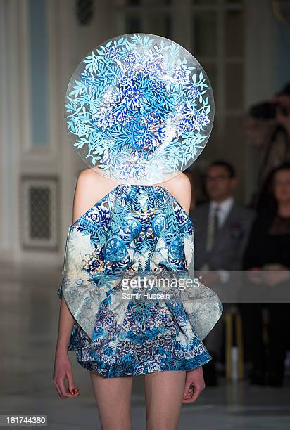A model walks the catwalk during the Fyodor Golan show during London Fashion Week Fall/Winter 2013/14 at The Savoy on February 15 2013 in London...