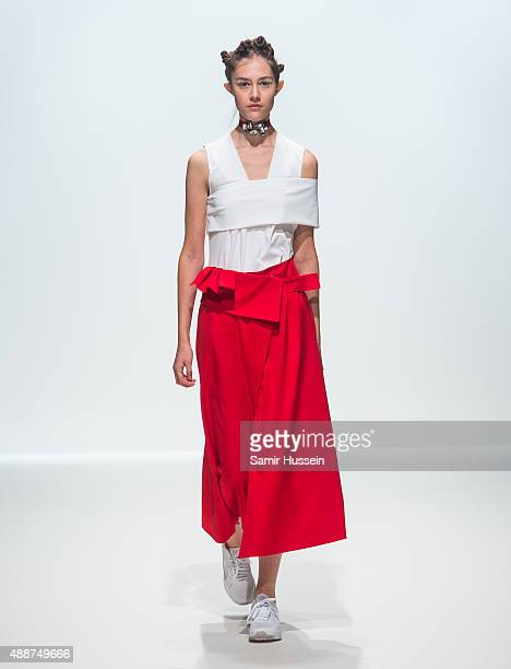 A model walks the catwalk during the Haizhen Wang Spring/Summer 2016 Runway Show at The Hospital Club on September 17 2015 in London England