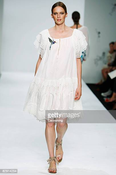 A model walks the catwalk during the Issa show part of London Fashion Week Spring/Summer 2009 on September 18 2008 in London England
