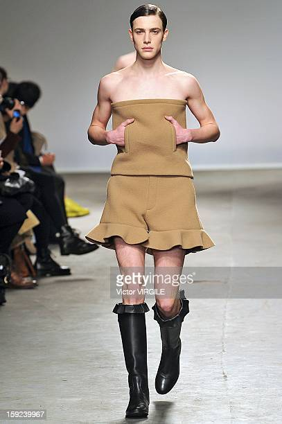 A model walks the catwalk during the JW Anderson Ready to wear Fall/Winter 20132014 show at the London Collections MEN AW13 at The Old Sorting Office...
