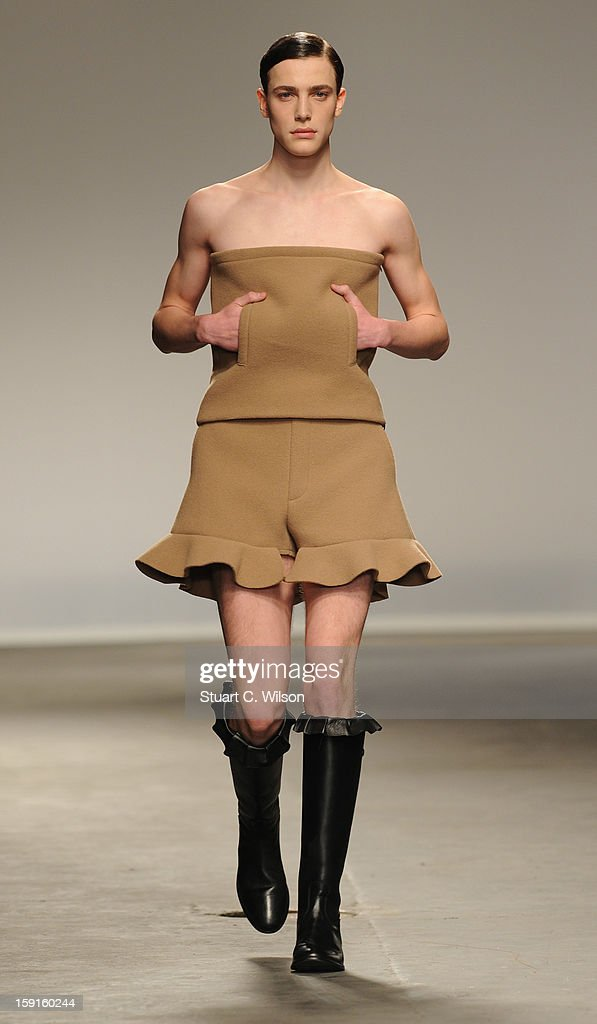 A model walks the catwalk during the J.W. Anderson show at the London Collections: MEN AW13 at The Old Sorting Office on January 9, 2013 in London, England.