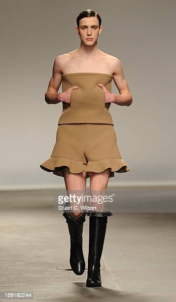 A model walks the catwalk during the JW Anderson show at the London Collections MEN AW13 at The Old Sorting Office on January 9 2013 in London England
