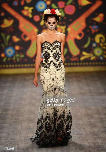 A model walks the catwalk during the Lena Hoschek Runway at the MercedesBenz Fashion Week Spring/Summer 2013 on July 4 2012 in Berlin Germany