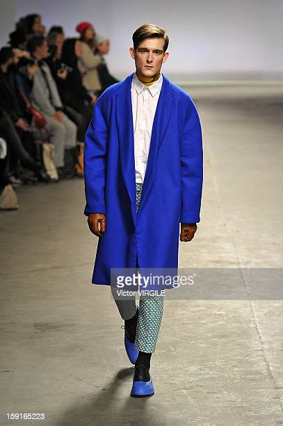 Model walks the catwalk during the MAN - Agi & Sam Ready to wear Fall/Winter 2013-2014 show at the London Collections: MEN AW13 at The Old Sorting...