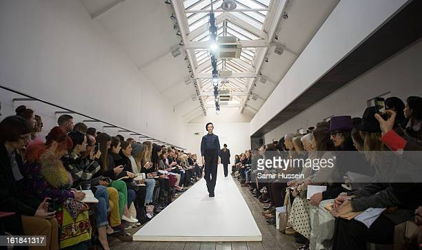 Model walks the catwalk during the Margaret Howell show at the Margaret Howell store during London Fashion Week Fall/Winter 2013/14 on February 17,...