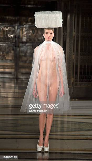 A model walks the catwalk during the Pam Hogg show at Freemasons Hall during London Fashion Week Fall/Winter 2013/14 on February 16 2013 in London...