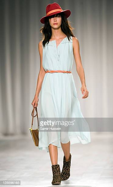 A model walks the catwalk during the Paul Smith LFW Spring/Summer 2012 show at the Royal Horticultural Society on September 18 2011 in London England