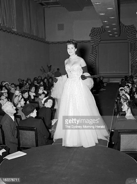 Model walks the catwalk during the Pierre Balmain fashion parade at David Jones Factory on September 13, 1947 in Sydney,Australia.