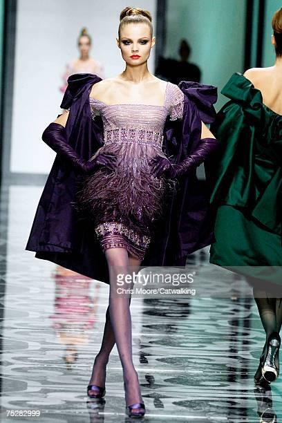 A model walks the catwalk during the Valentino 45th Anniversary Fall/Winter Haute Couture Fashion Show at the Santo Spirito in Sassia complex on July...