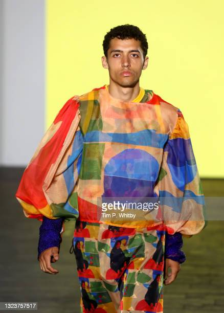 Model walks the catwalk wearing designs by Raiesa Salum Al-Kilaly during the Edinburgh College of Art show, part of Graduate Fashion Week 2021 at...