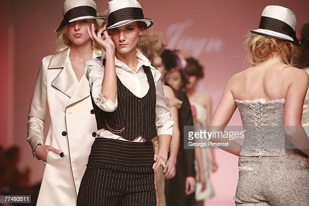 A model walks the catwalk wearing Jayn Simpson Spring 2008 Collection at L'Oreal Toronto Fashion Week on October 24 2007 in Toronto Canada