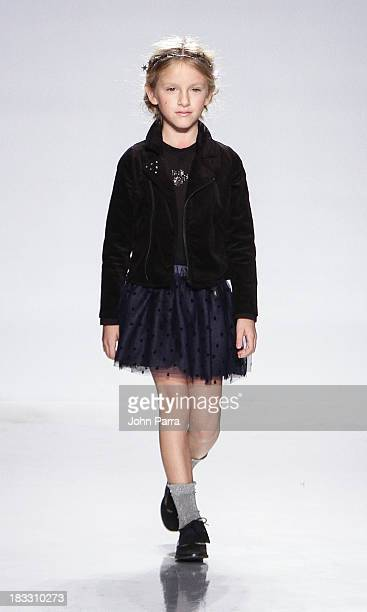Model walks the IKKS Junior preview during the Swarovski at petiteParade NY Kids Fashion Week in Collaboration with VOGUEbambini on October 5, 2013...