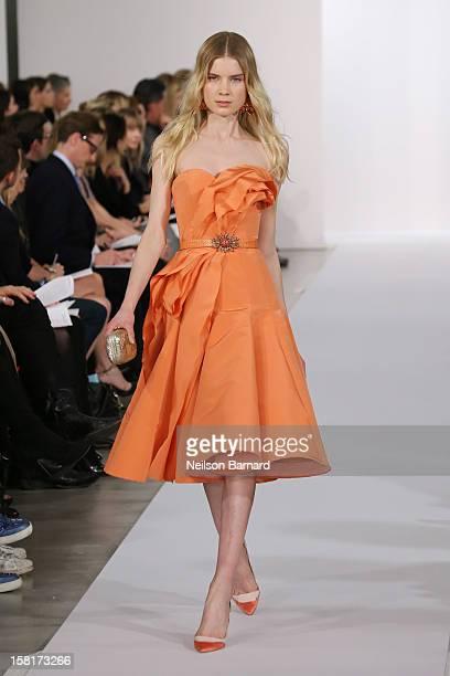 A model walks the Oscar de la Renta PreFall 2013 Collection Runway on December 10 2012 in New York City