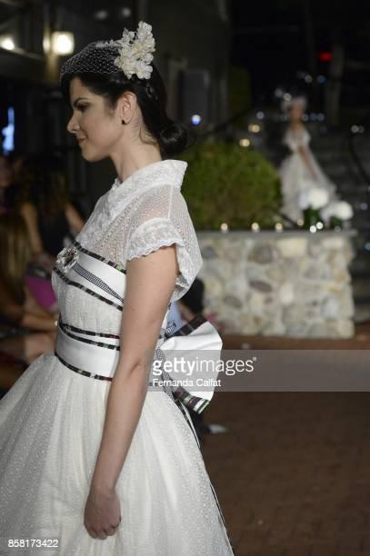 A model walks the Po de Arroz runway show at New York Fashion Week Bridal October 2017 at Hendrick's Tavern on October 5 2017 in Roslyn New York