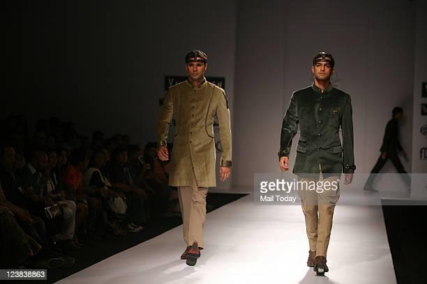 A model walks the ramp for designer Rohit and Abhishek during Van Heusen India Men's Week 2011 at The Grand Hotel in Delhi