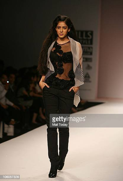A model walks the ramp for the show Walnut by Nidhi Divya Gambhir on the third day of the Wills Lifestyle India Fashion Week in New Delhi on October...