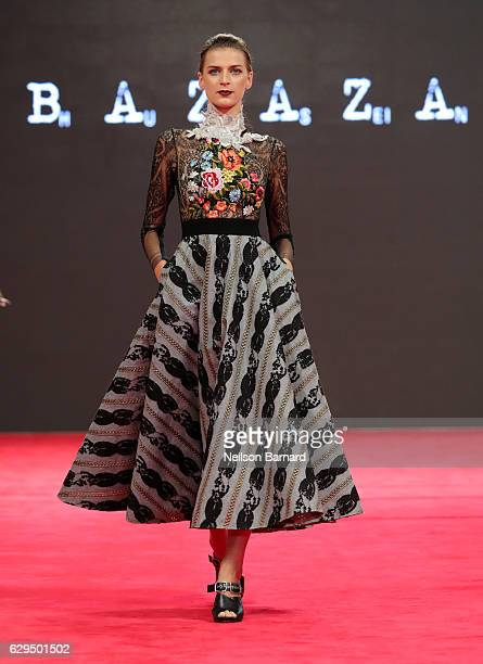 A model walks the red carpet at the Hussein Bazaza show during D3 Presents DIFF Fashion Forward on day seven of the 13th annual Dubai International...