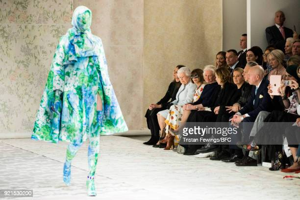 A model walks the Richard Quinn show with Queen Elizabeth II Chief Executive of the British Fashion Council Caroline Rush and Anna Wintour in...