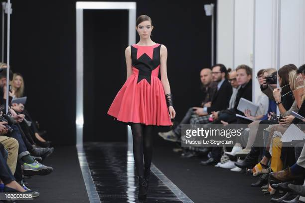 A model walks the run way during the Maxime Simoens Fall/Winter 2013 ReadytoWear show as part of Paris Fashion Week on March 3 2013 in Paris France