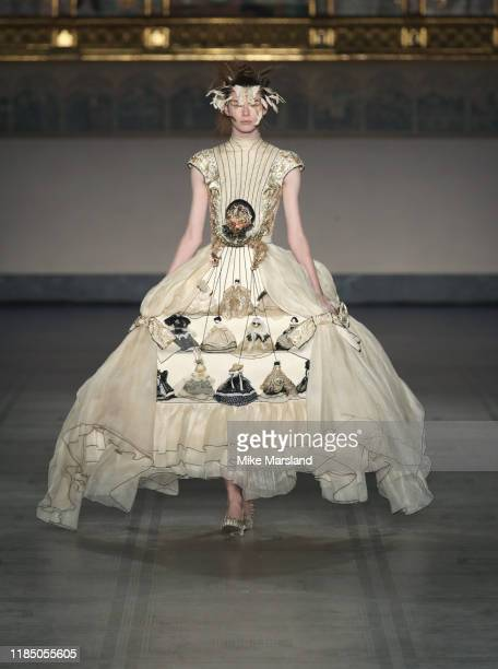 A model walks the runay during the Fashion In Motion Guo Pei show at The VA on November 01 2019 in London England