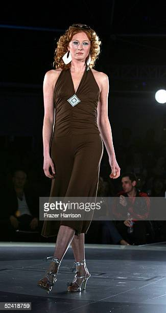 A model walks the runway aduring the Pret A PSP fashion show to celebrate the launch of the PlayStation handheld entertainment system at the Pacific...