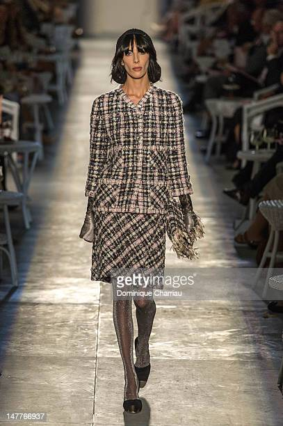 A model walks the runway after the Chanel HauteCouture Show as part of Paris Fashion Week Fall / Winter 2013 at Grand Palais on July 3 2012 in Paris...