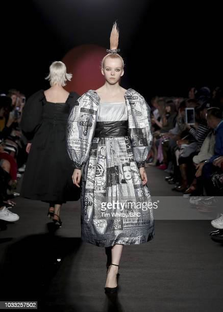 A model walks the runway and closes the Ashley Williams presentation during London Fashion Week September 2018 at the House of Vans on September 14...