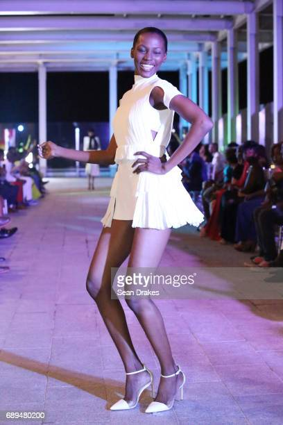 A model walks the runway as part of the Greta Constantine show during StyleWeek Jamaica 2017 at the roof of Digicel headquarters on May 27 2017 in...