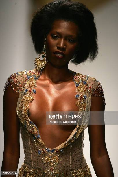 A model walks the runway as part of Valentin Yudashkin's Spring/Summer 2006 women's fashion show during Milan Fashion Week September 28 2005 in Milan...