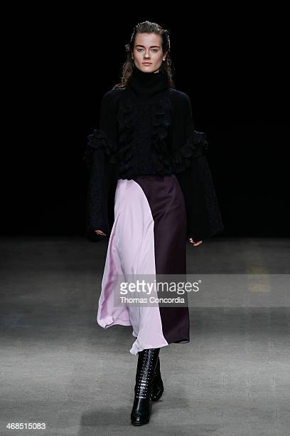 Model walks the runway at 3.1 Phillip Lim during Mercedes-Benz Fashion Week Fall 2014 at Skylight at Moynihan Station on February 10, 2014 in New...