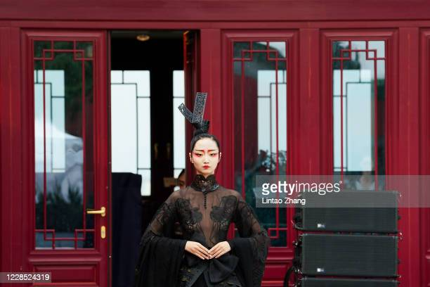 Model walks the runway at a collection show by Chinese designer Liu Wei during the day one of Beijing Fashion Week at Longfu Culture Center on...