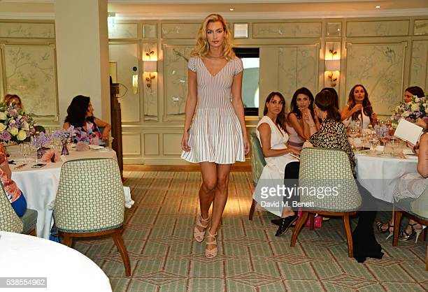 A model walks the runway at a lunch hosted by Tamara Beckwith and Alessandra Vicedomini to celebrate luxury fashion brand Vicedomini at Fortnum Mason...