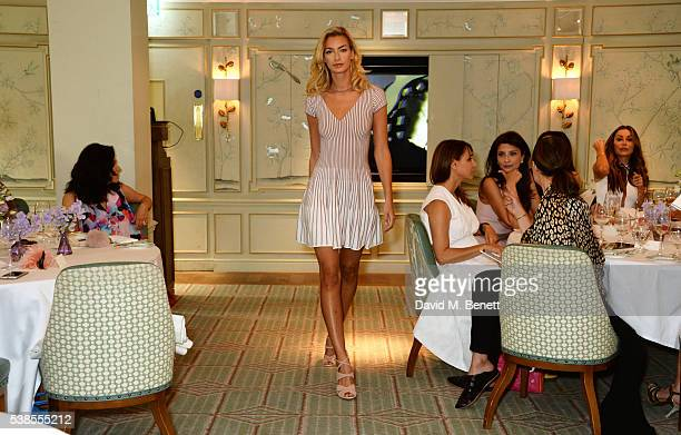 Model walks the runway at a lunch hosted by Tamara Beckwith and Alessandra Vicedomini to celebrate luxury fashion brand Vicedomini at Fortnum & Mason...