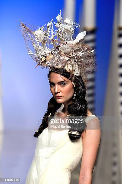 A model walks the runway at a presentation of the latest bridal collection by Victorio and Lucchino during Barcelona Bridal Week on May 11 2011 in...