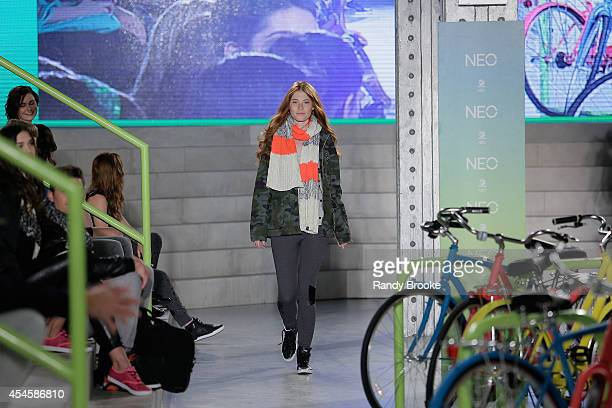 Model walks the runway at Adidas Neo during MercedesBenz Fashion Week Spring 2015 at The Waterfront on September 3 2014 in New York City