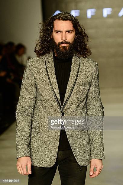 A model walks the runway at Affairs spring/winter 20152016 show during Mercedes Benz Fashion Week at the Istanbul Modern in Turkey on March 162015