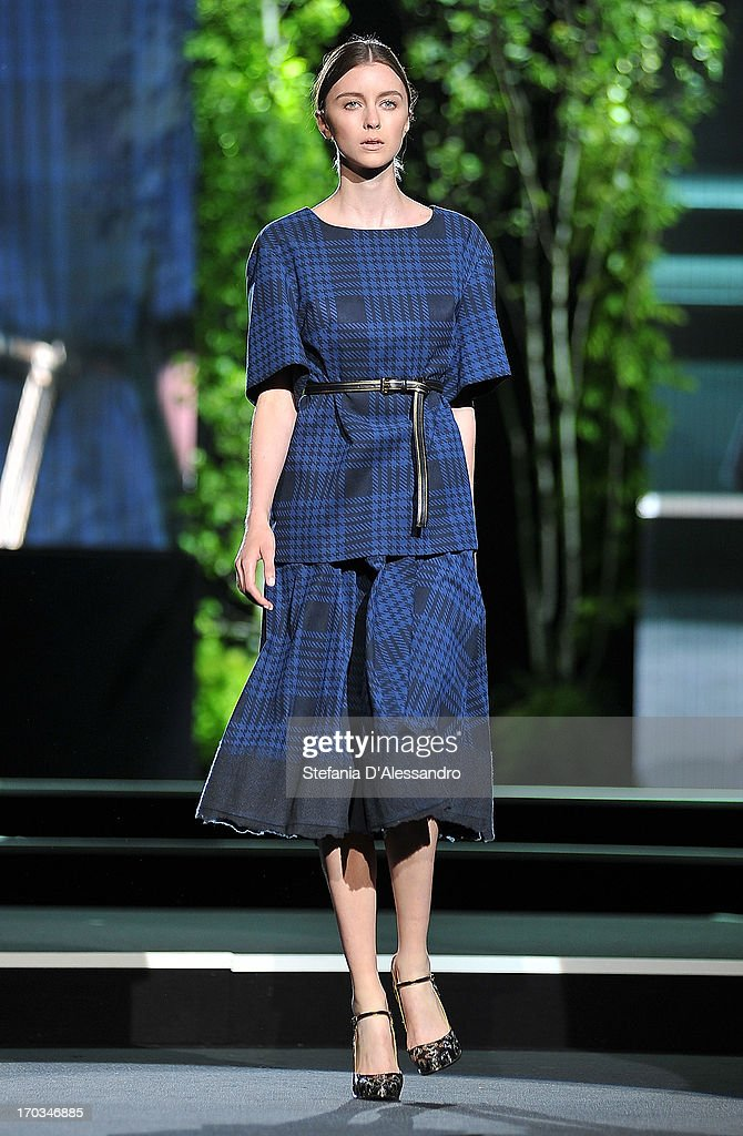 A model walks the runway at Alcantara featuring Aquilano + Rimondi fashion show as part of Glamour Live Show on June 11, 2013 in Milan, Italy.