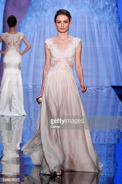 A model walks the runway at Alessandra Rinaudo Season 2017 show during Si SposaItalia Collezioni Milano on May 22 2016 in Milan Italy