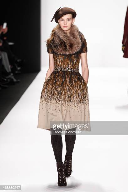 A model walks the runway at Badgley Mischka during MercedesBenz Fashion Week Fall 2014 at The Theatre at Lincoln Center on February 11 2014 in New...