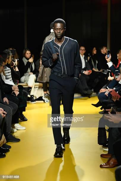 A model walks the runway at BOSS Menswear February 2018 New York Fashion Week Mens' on February 7 2018 in New York City