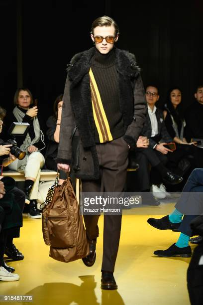 A model walks the runway at BOSS Menswear February 2018 New York Fashion Week Mens' on February 7 2018 in New York City