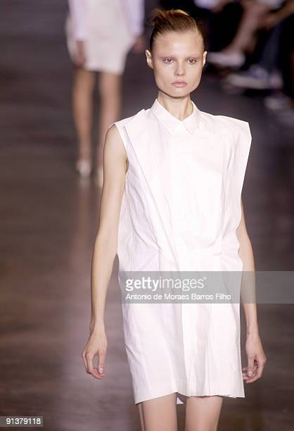 A model walks the runway at Cacharel Pret a Porter during Paris Womenswear Fashion Week Spring/Summer 2010 at Palais de Tokyo on October 3 2009 in...