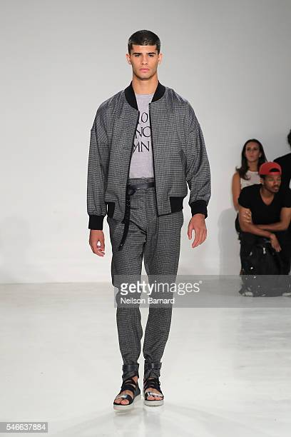 A model walks the runway at Cadet fashion show during New York Fashion Week Men's S/S 2017at Skylight Clarkson Sq on July 12 2016 in New York City