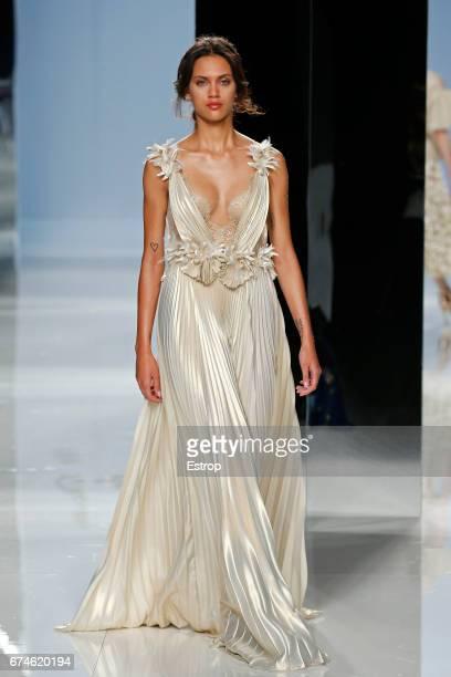97f8dc9e0b8 A model walks the runway at Carla Ruiz show during Barcelona Bridal Fashion  Week 2017 on