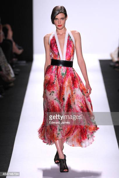 Model walks the runway at Carmen Marc Valvo during Mercedes-Benz Fashion Week Spring 2015 at The Theatre at Lincoln Center on September 5, 2014 in...